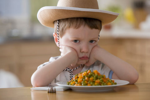 unhappy-boy-sitting-at-dinner-table